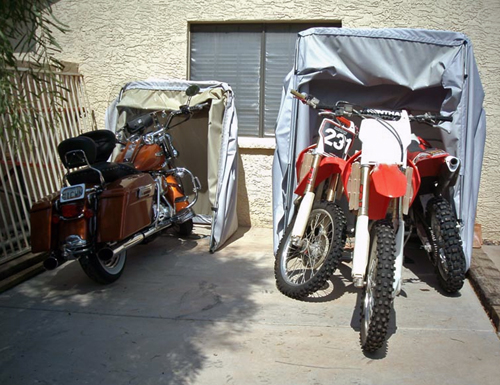 Harley Road King in a standard bike barn cover and three dirt bikes in one tourer model bike barn