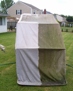 Use pressure washer on motorcycle cover to remove mildew and dirt